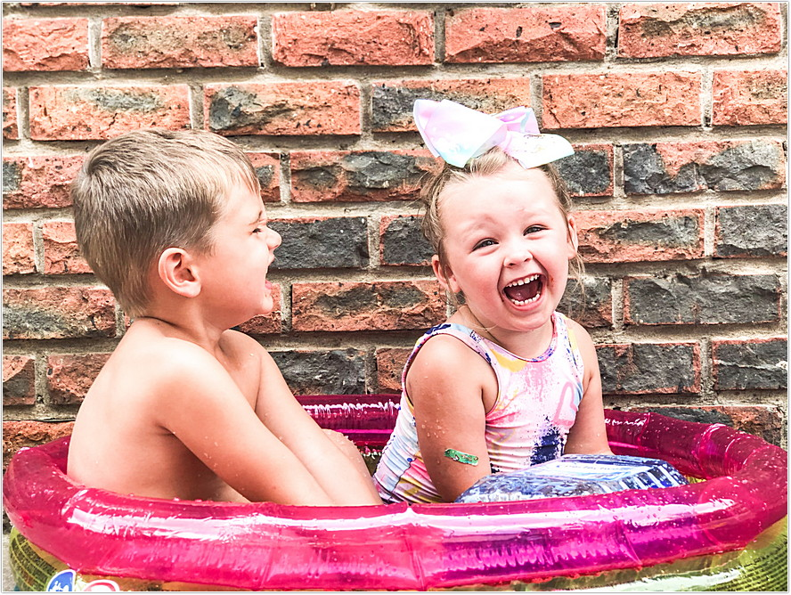 toddler boy and girl playing with gellibaff from zimpli kids in swimming pool