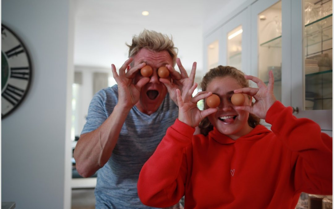 matilda and her dad gordon ramsay holding eggs in front of their eyes to promote cooking show on da vinci tv